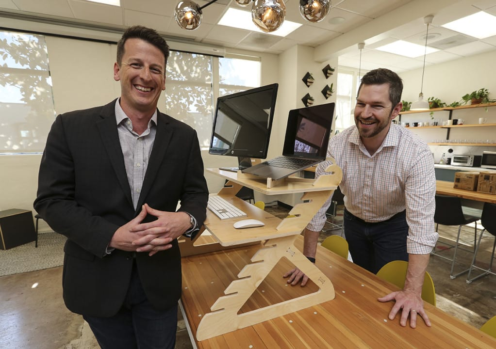 Feb. 16, 2018. San Diego, Ca.| Ben Larson, right, and Joe Nafziger co-owner of Readydesk with one of their stand up desk. |Photos by Jamie Scott Lytle. Copyright.